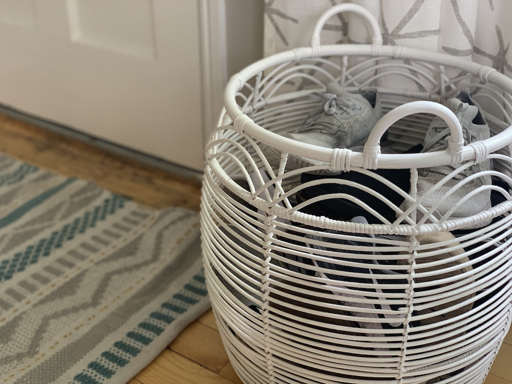 large white shoe basket next to front door