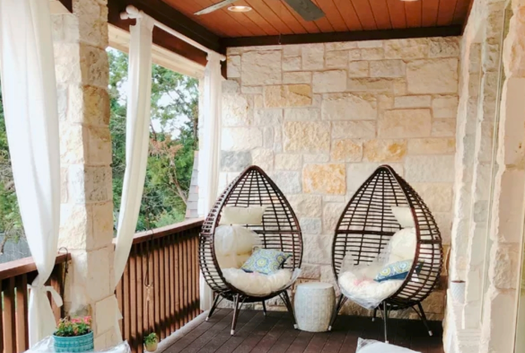 two black egg chairs sitting on porch