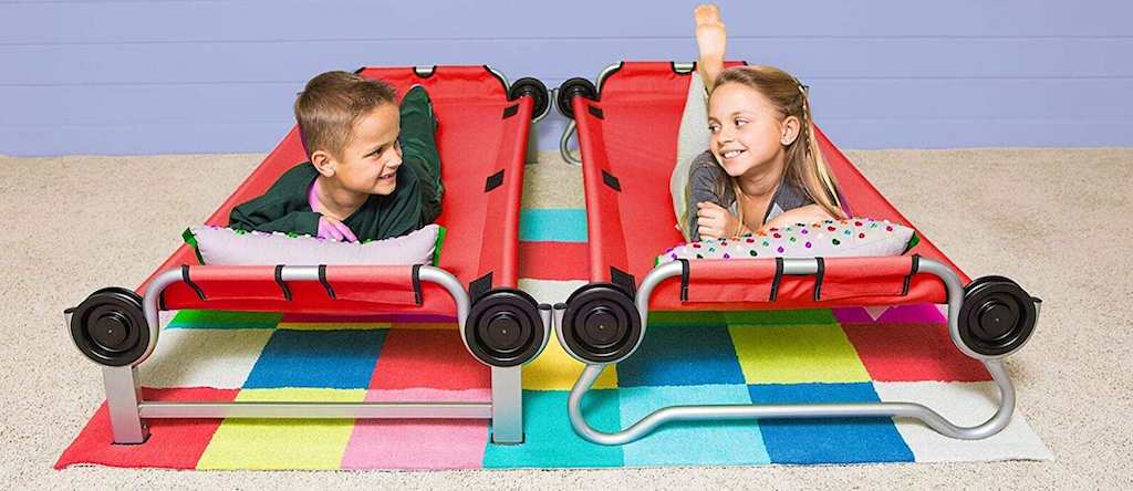 kids laying on red portable bunk beds