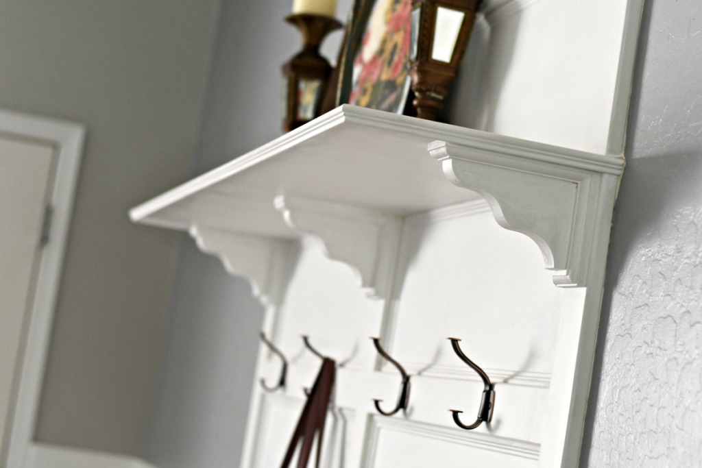 top shelf with wood corbels as part of the DIY hall tree project