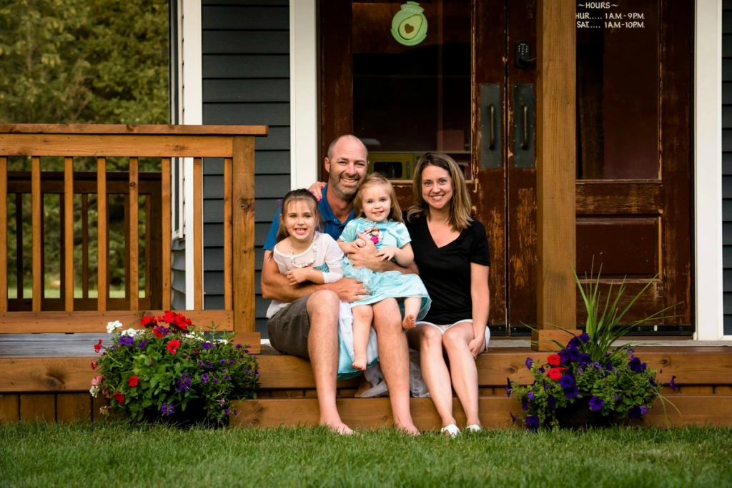 Adam Boyd family sitting on front porch