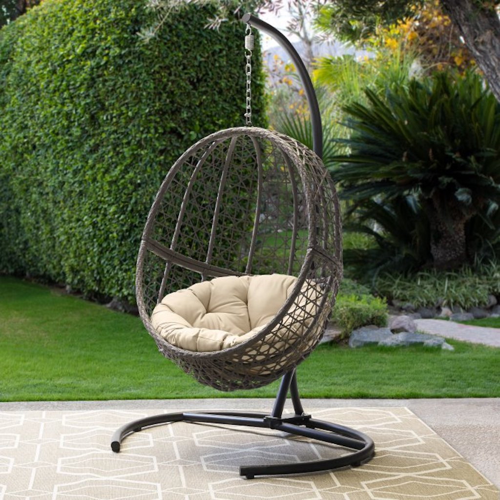 wicker hanging egg chair in backyard