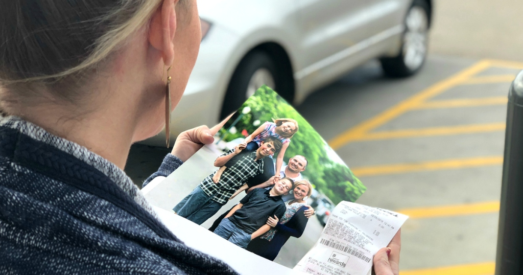 Collin holding walgreens photo of family