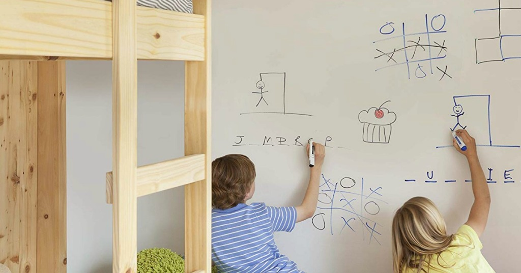 kids writing on dry erase board wall