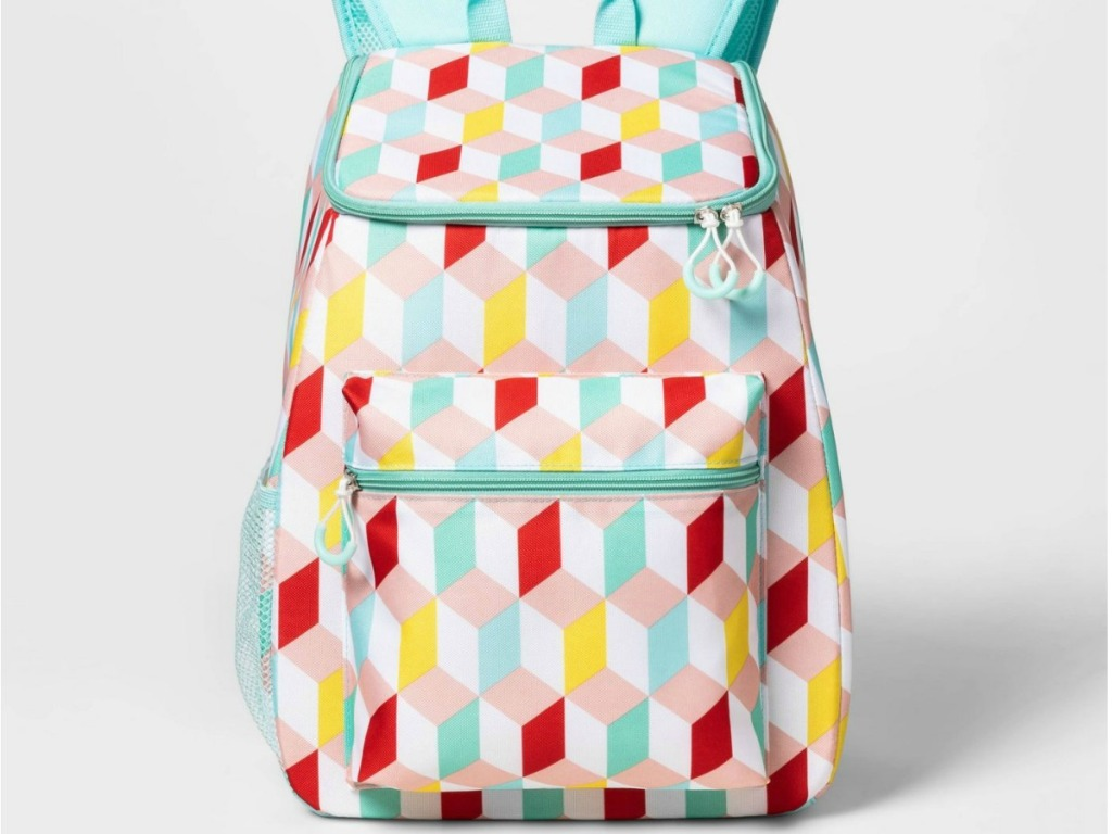 geo print backpack with teal, red, and yellow colors