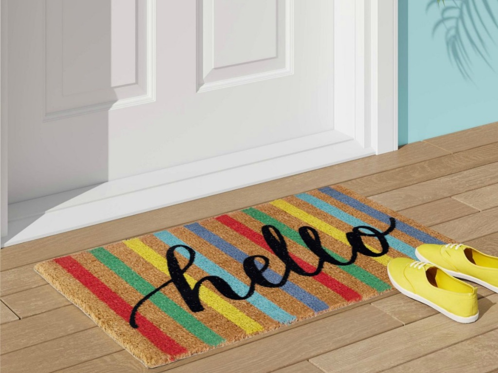 colorfully striped doormat with hello in script