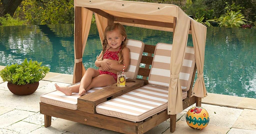 girl sitting in KidKraft Tan & White Double Chaise Lounge Set - Oatmeal