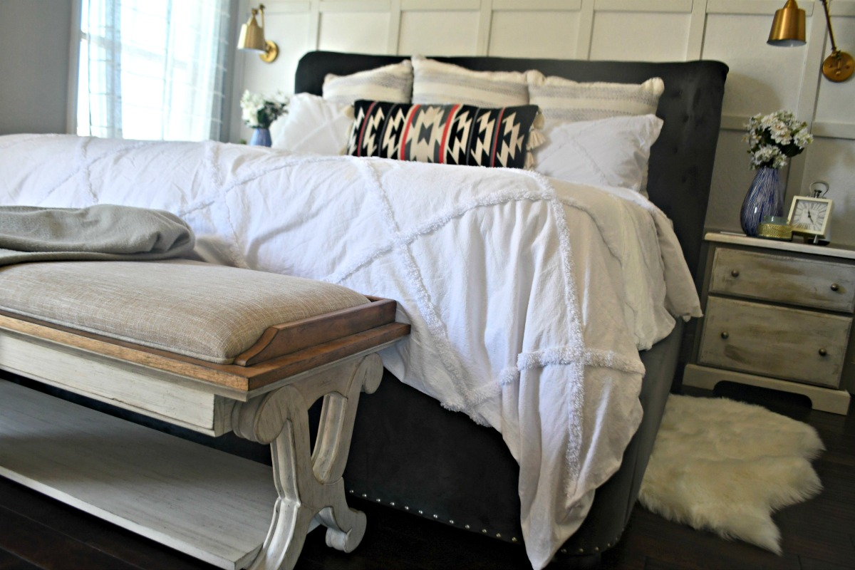 farmhouse style bench at the end of bed