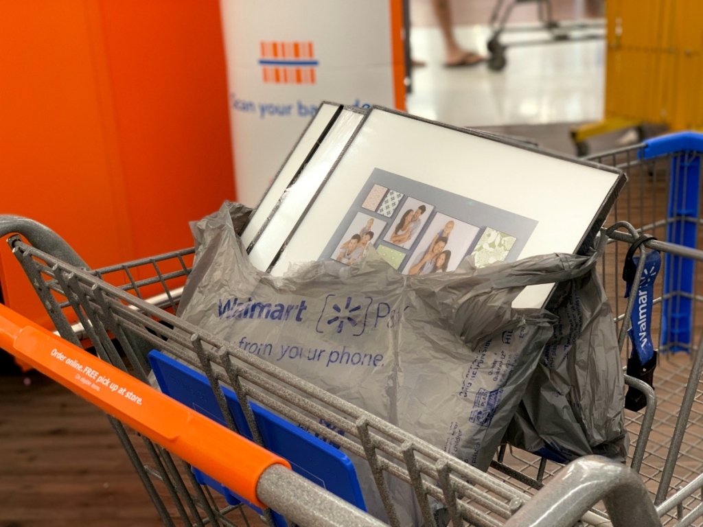Walmart cart with Mainstays picture frames