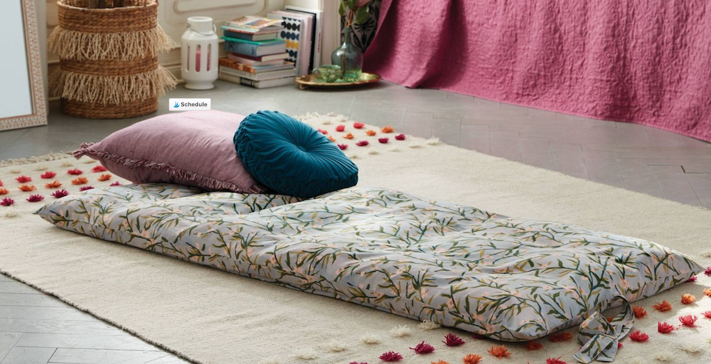 floral throw bed on bedroom floor