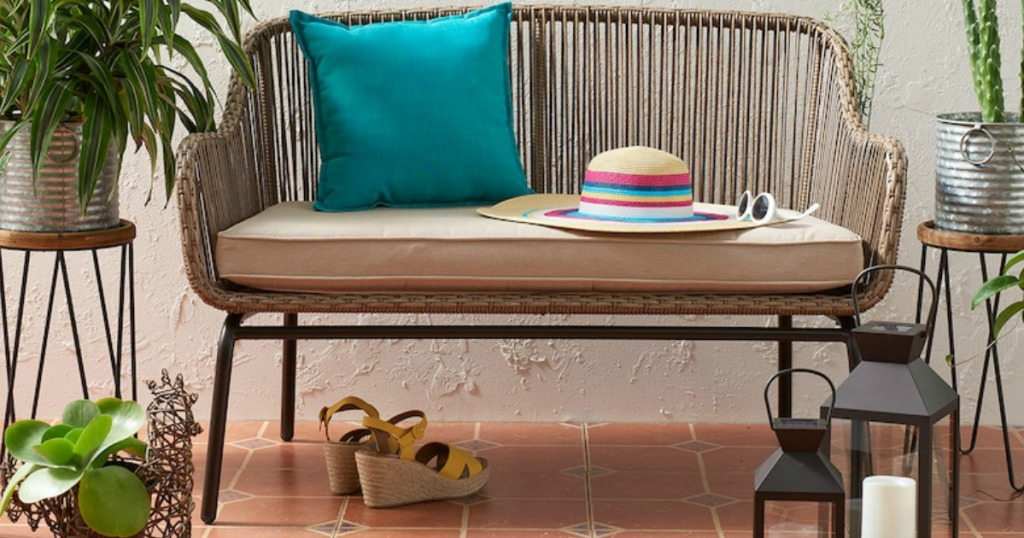 Sonoma wicker loveseat with cushion and sun hat