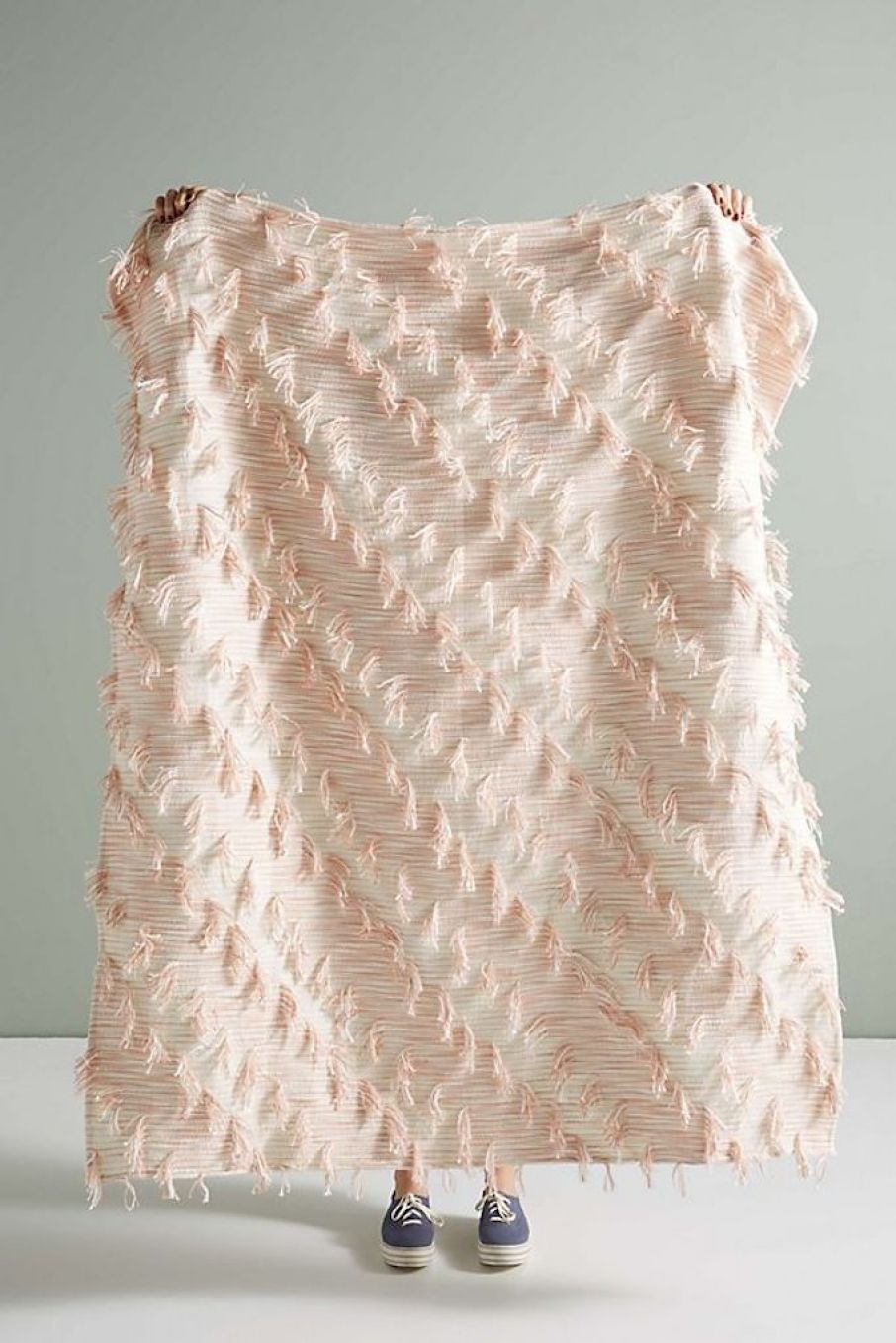 holding Anthropologie throw blanket