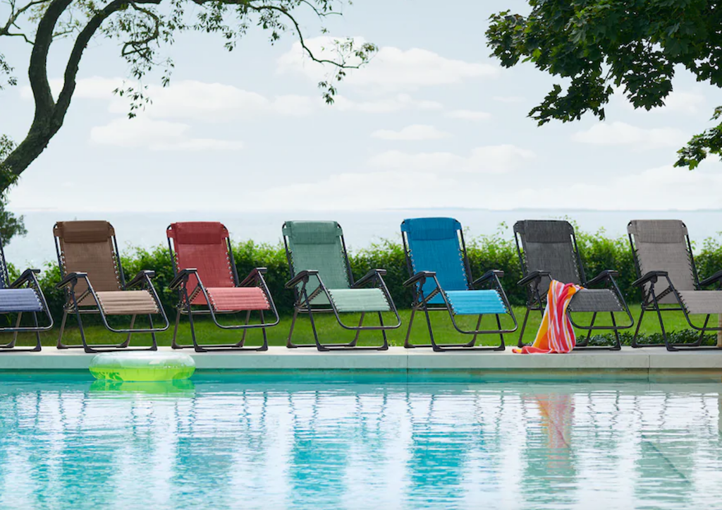 anti-gravity chairs lined up by pool