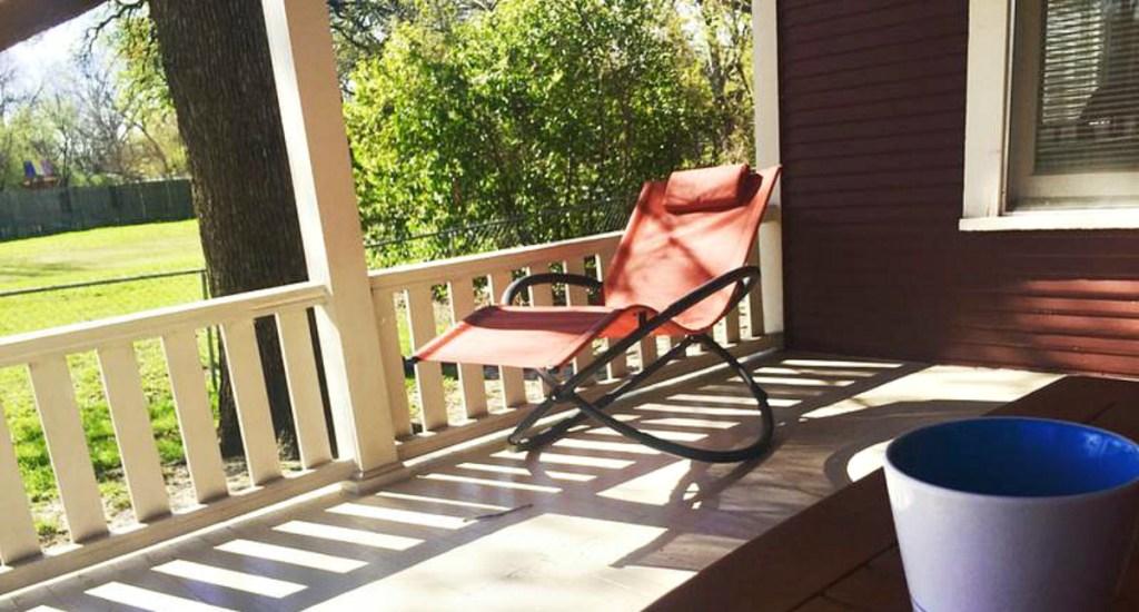 orange orbital chair on front porch