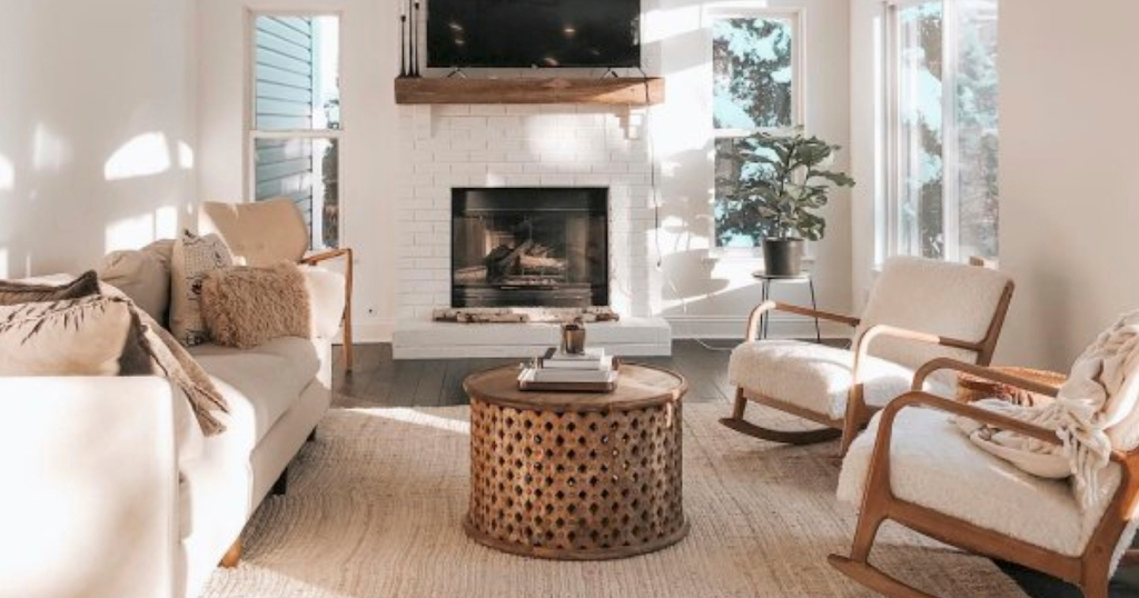 neutral living room with large jute rug and other white and brown furniture