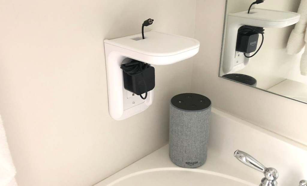 white outlet shelf with amazon alexa sitting on bathroom sink