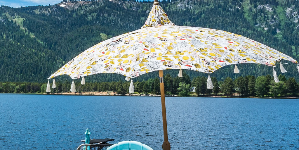 Opalhouse floral patio umbrella with lake in the background