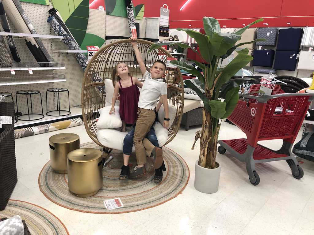 kids playing in egg chair at Target