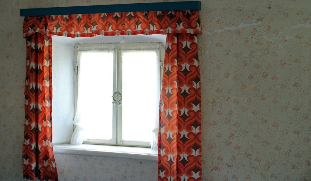 window with ugly red orange curtains