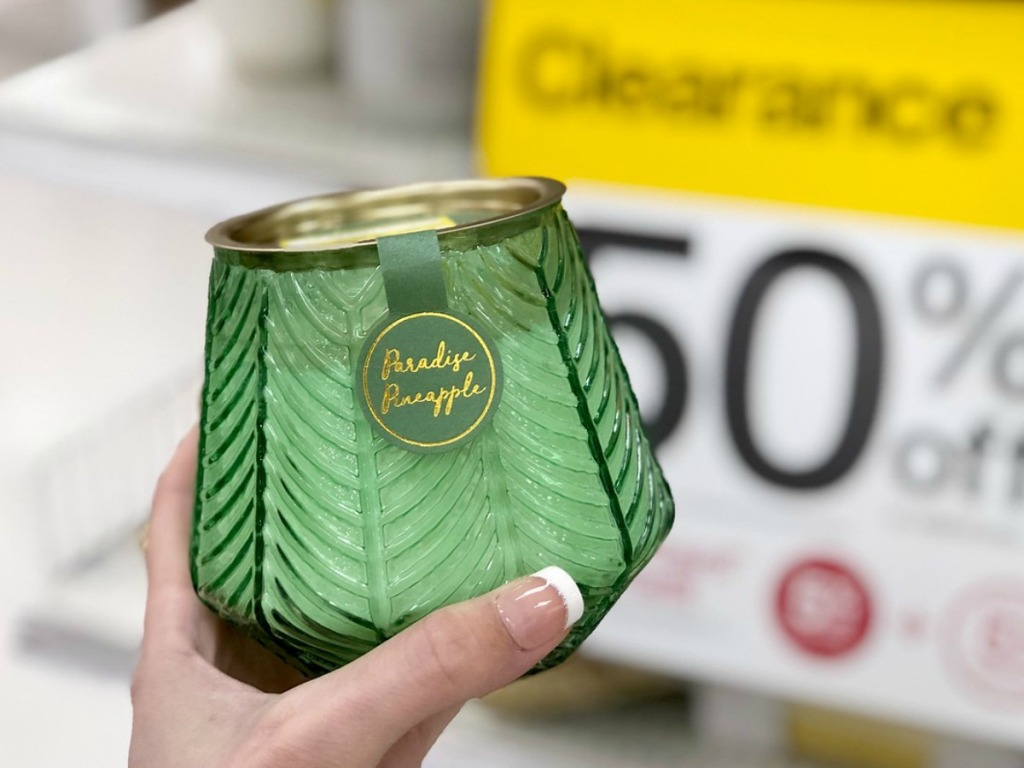 hand holding green candle in a store