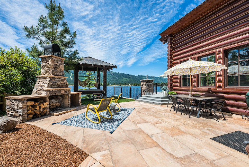 outdoor patio with firepit on lake