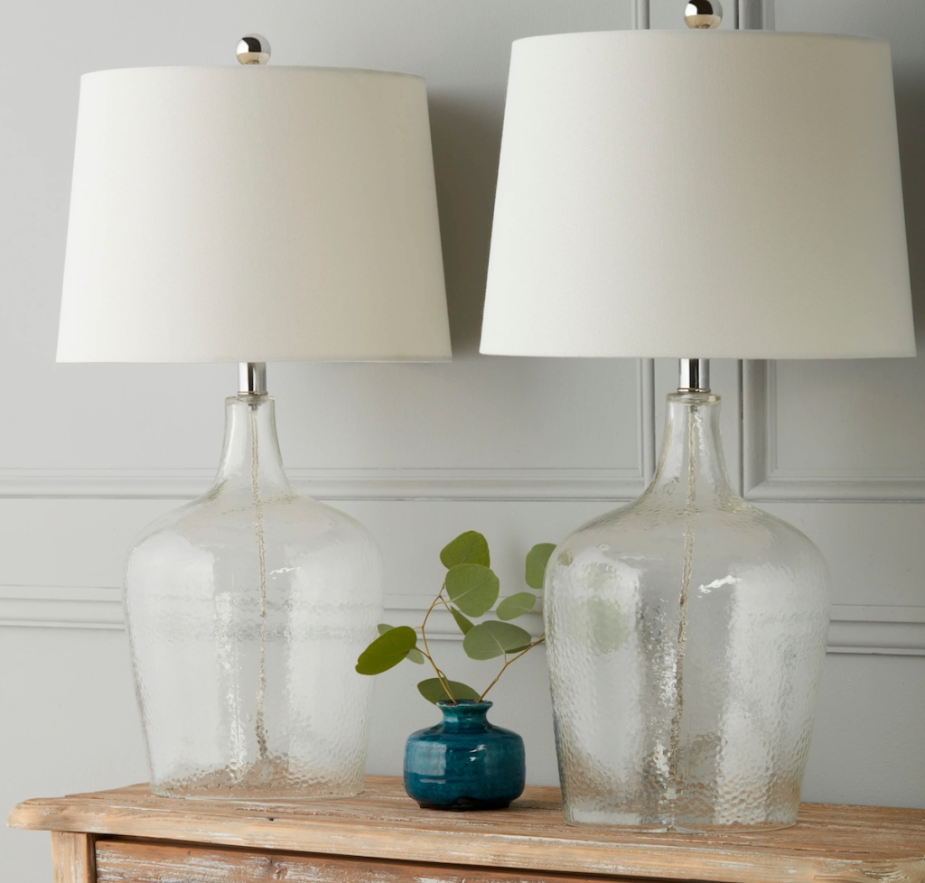 two glass table lamps with white lamp shades