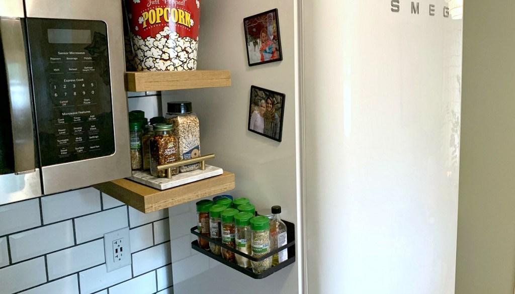 side of fridge holding spice rack organizer