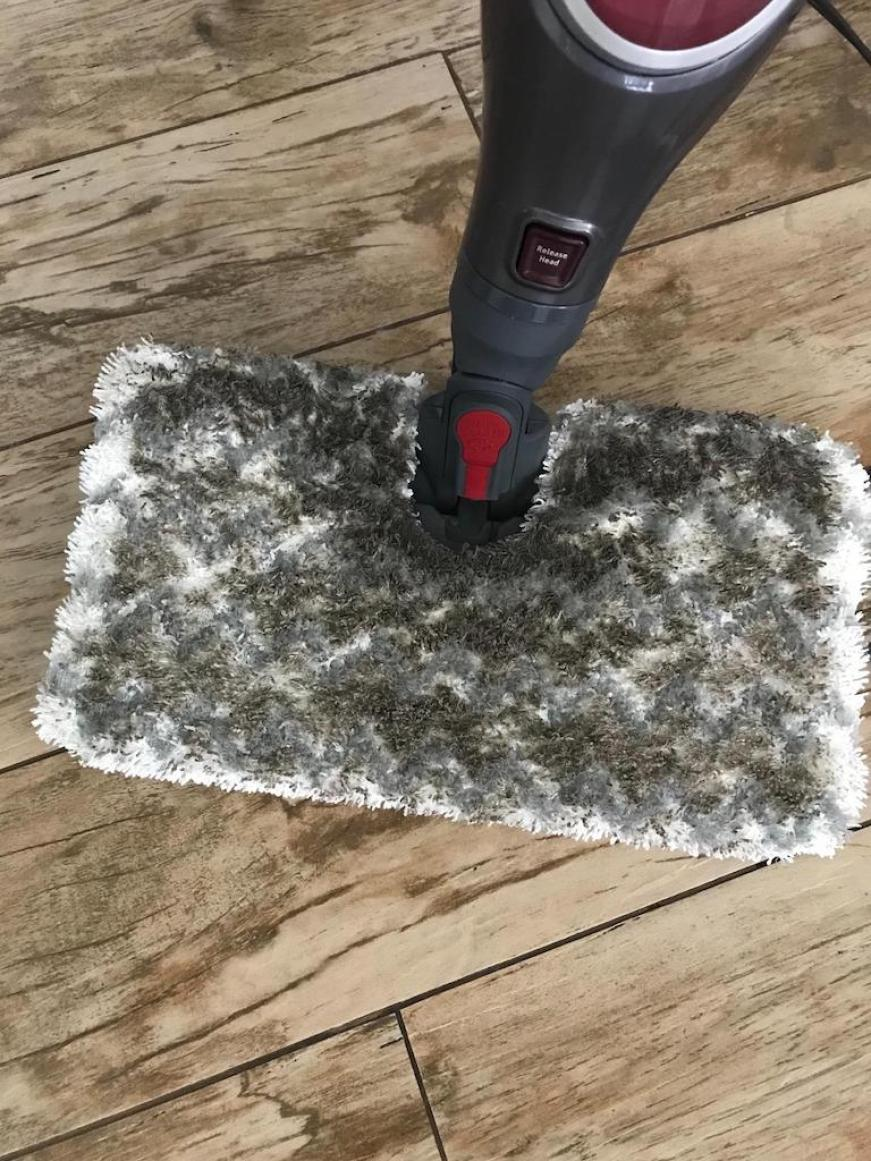 steam mop with dirty pad on hardwood floors