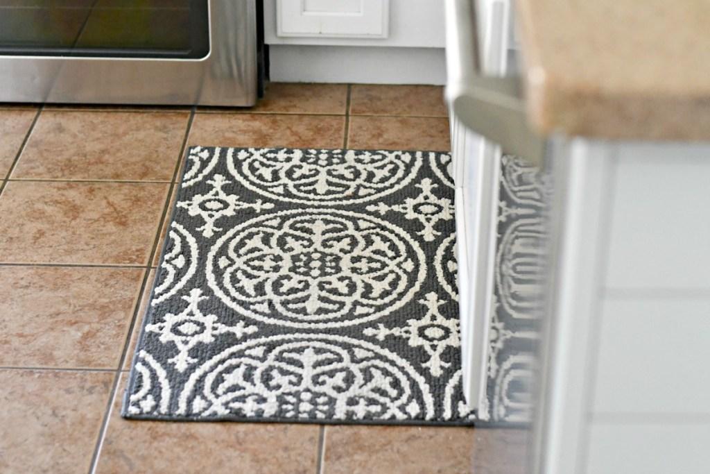threshold grey medallion washable rug on the kitchen floor