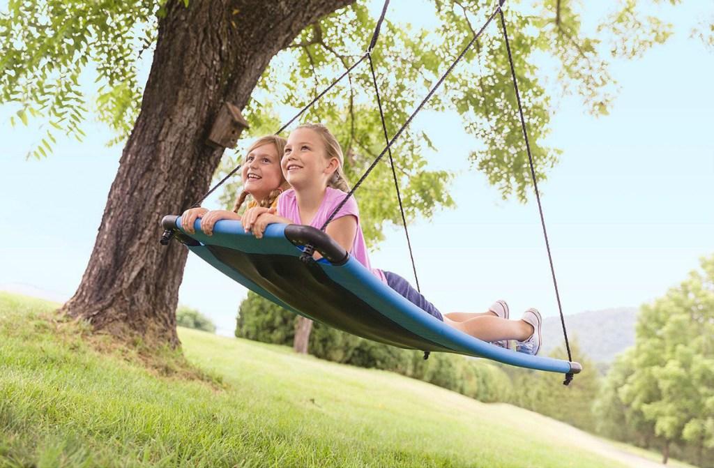 2 girls having fun swinging