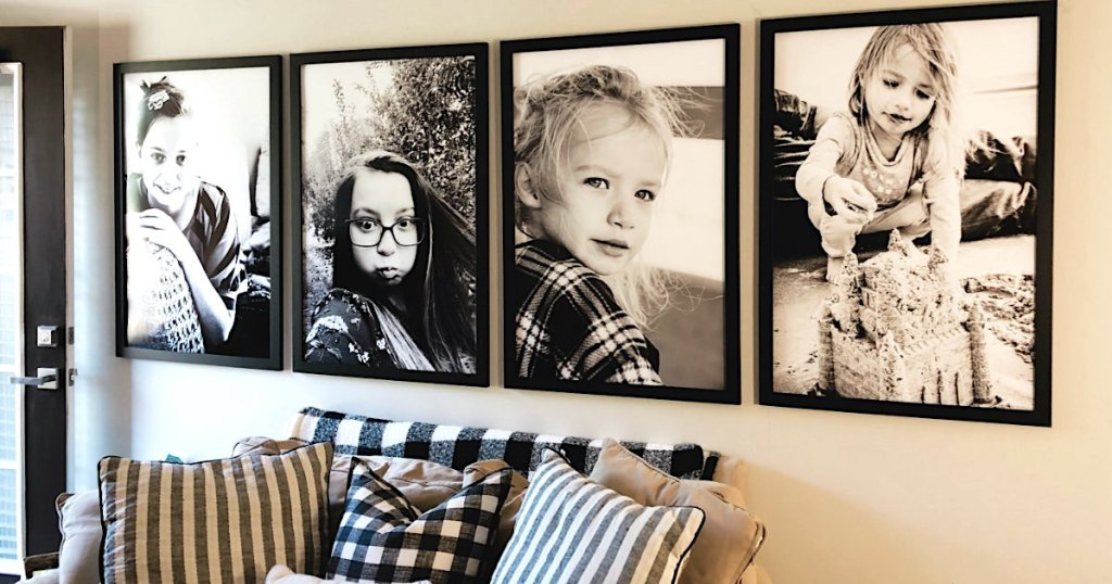 photo gallery with 4 black and white framed poster prints over couch