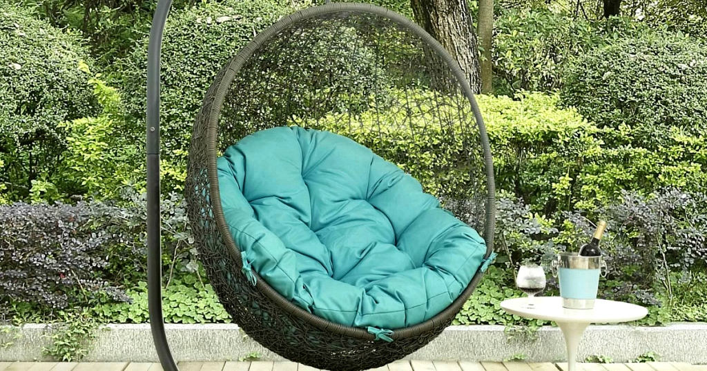 Mercury Row Valletta Swing Chair with Stand with turquoise cushion