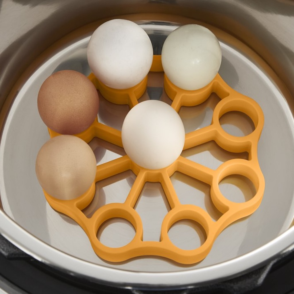 silicone egg rack with eggs in pressure cooker