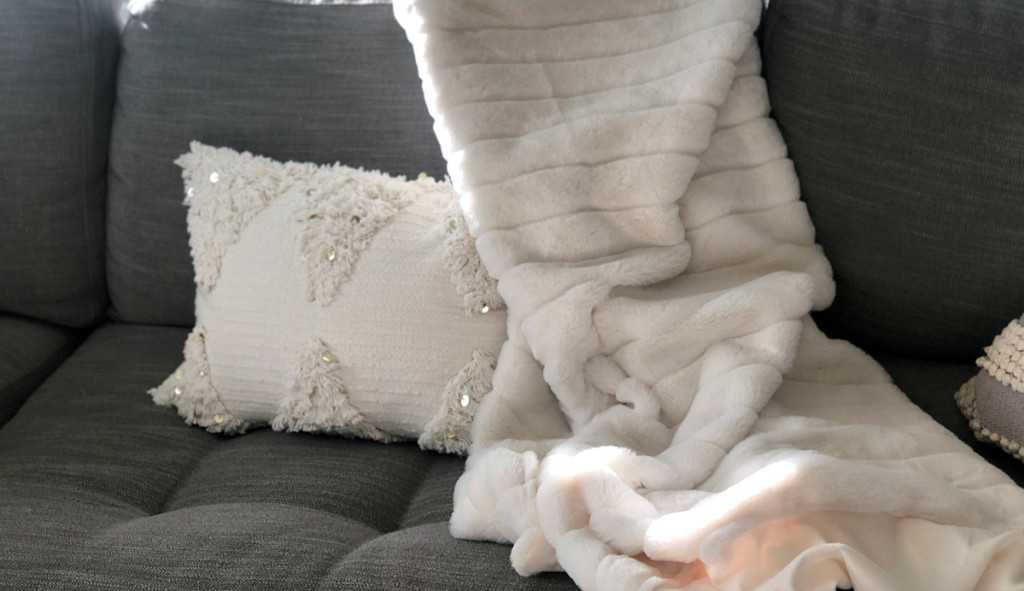 opalhouse cream fringe pillow on couch from target