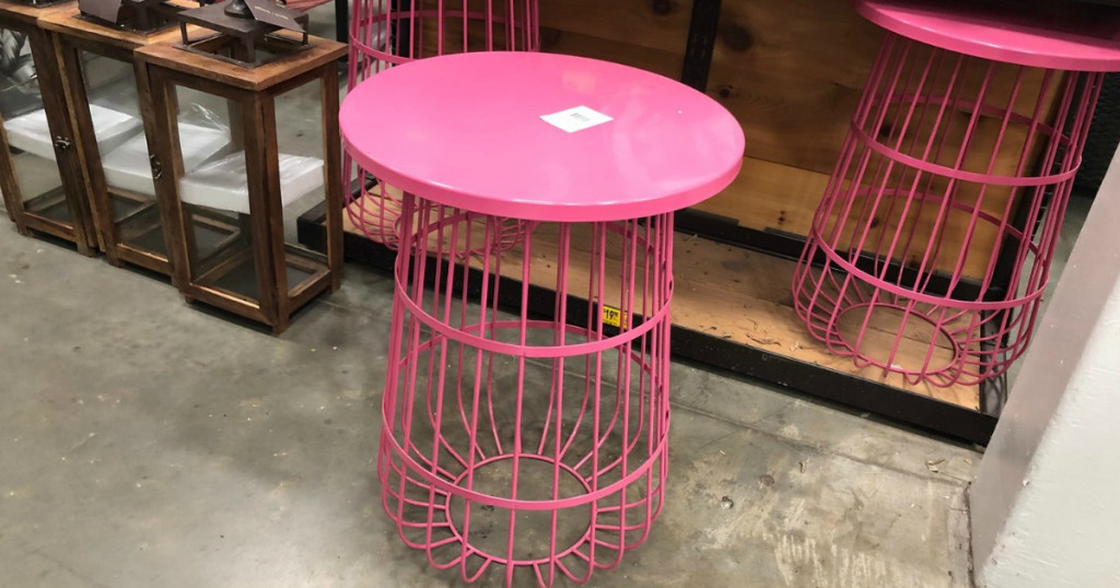 Pink wire plant stand sitting on the floor