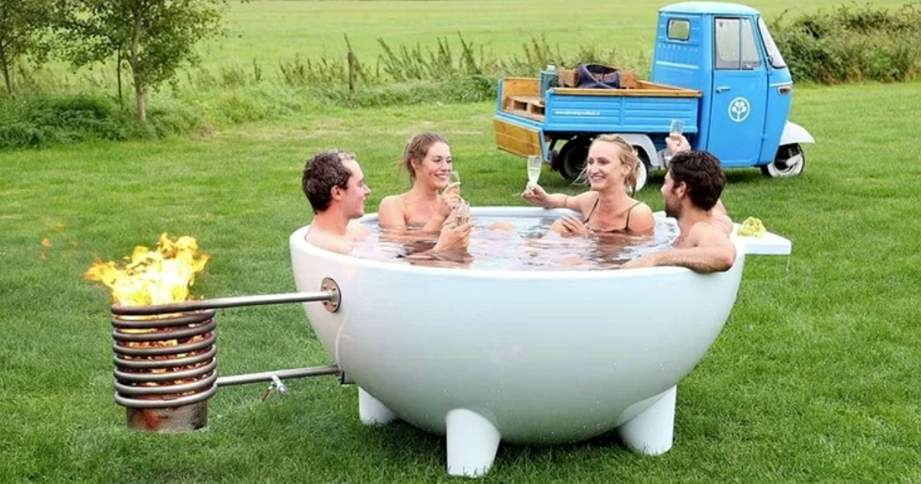 people sitting in outdoor hot tub