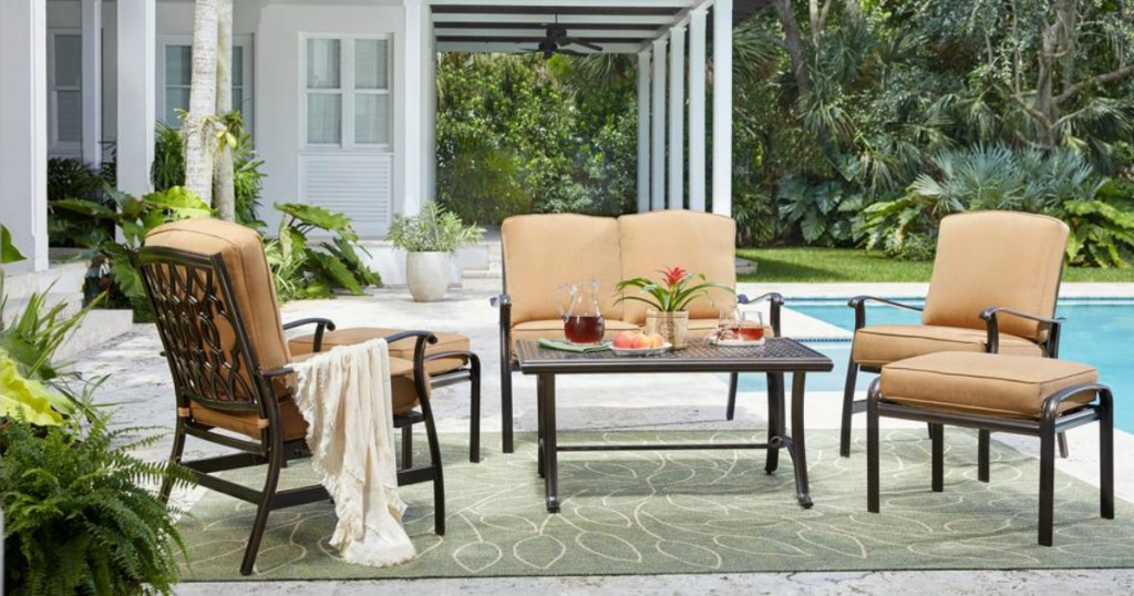 large outdoor aluminum patio set with cushions by pool