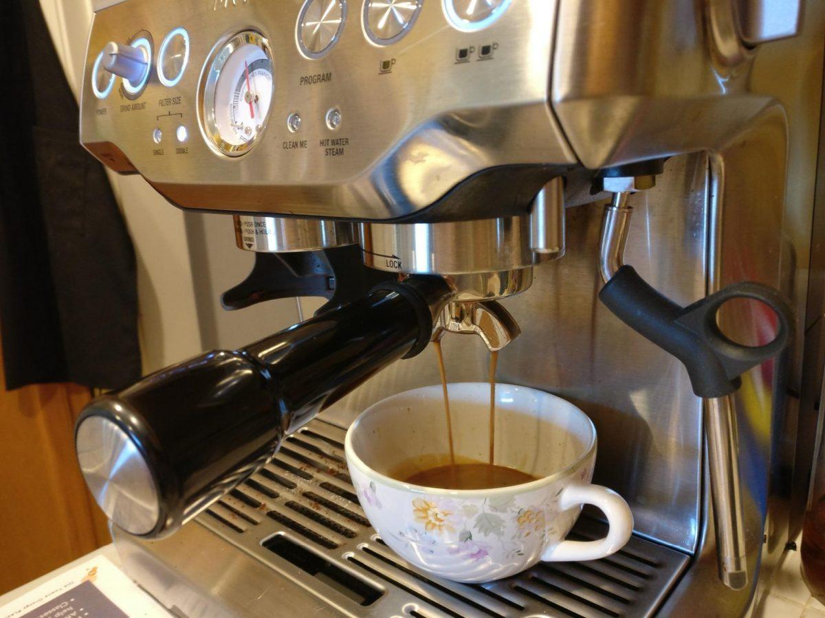 Breville espresso machine making a latte