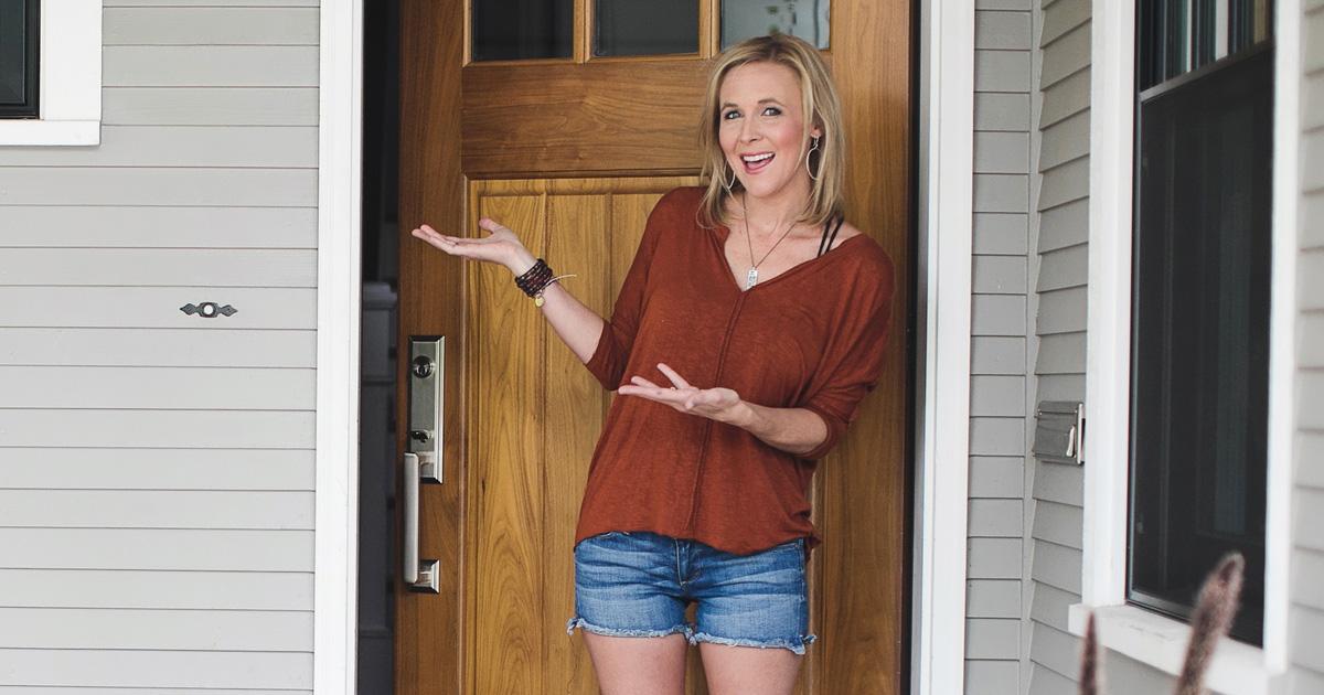 woman at home standing in front door
