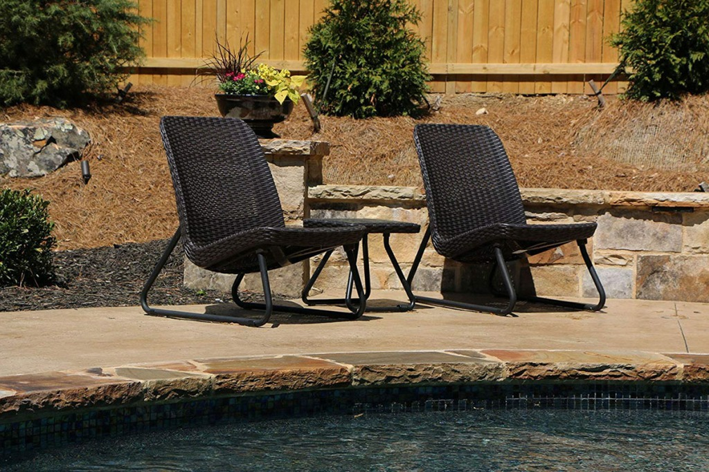 chairs and table by a pool