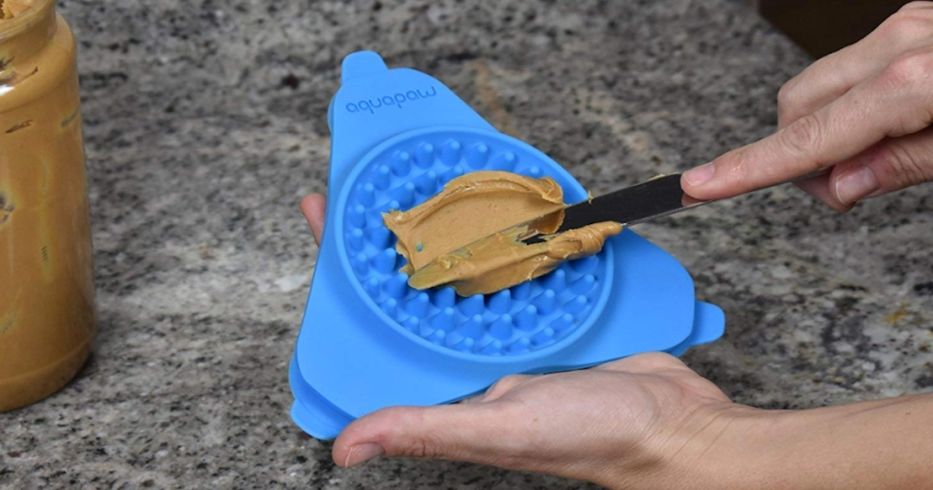 blue silicone triangle mat with peanut butter