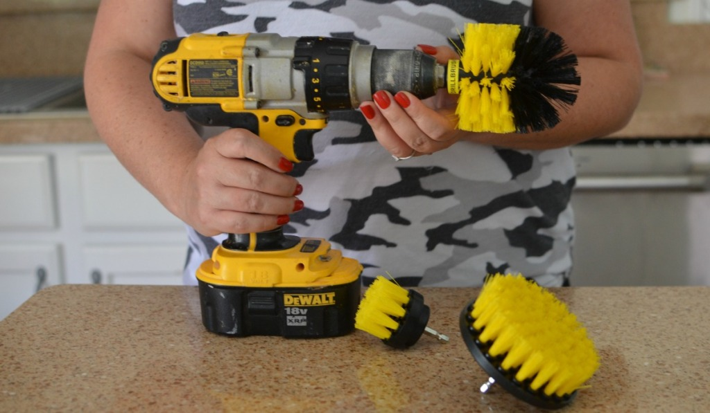 holding a drillbrush cleaning tool drill attachment