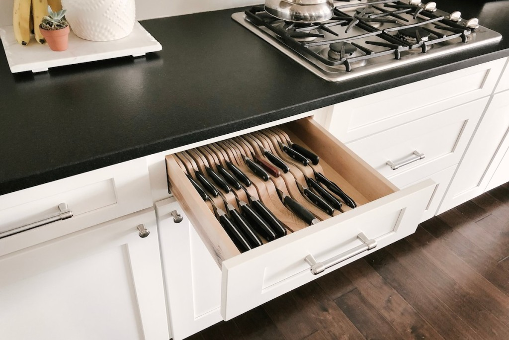 open kitchen drawer with organized knife block