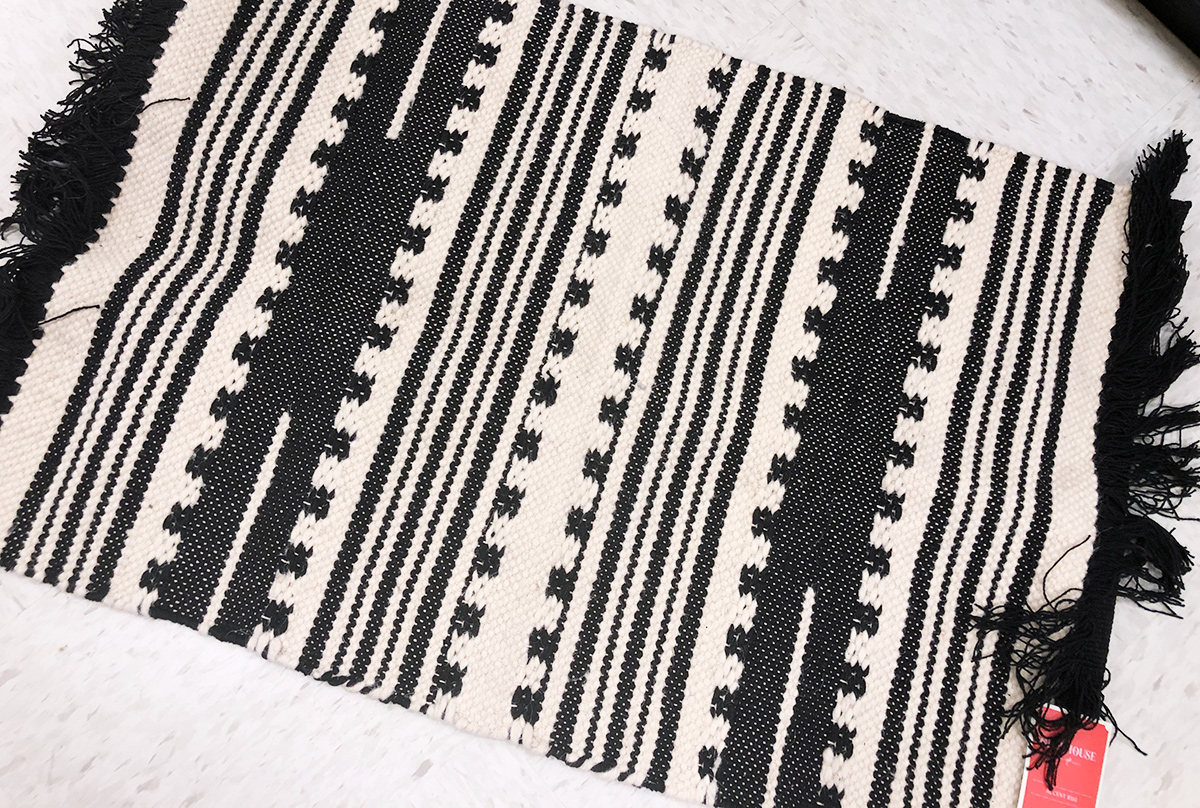 geometric black and white tassle rug from target