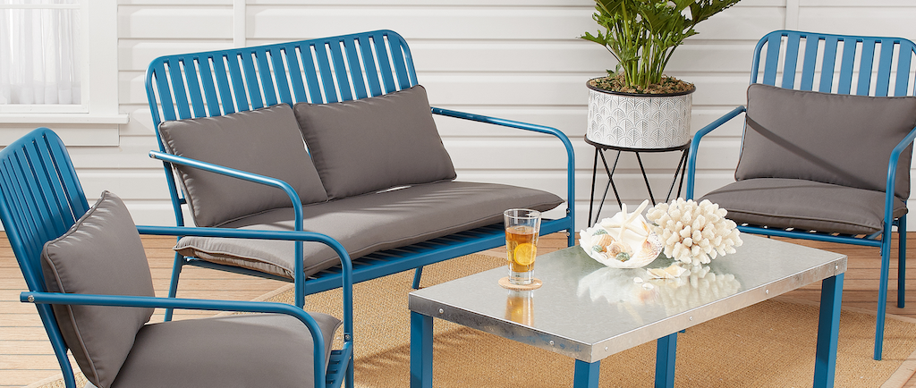 modern patio set with blue metal chairs and love seat
