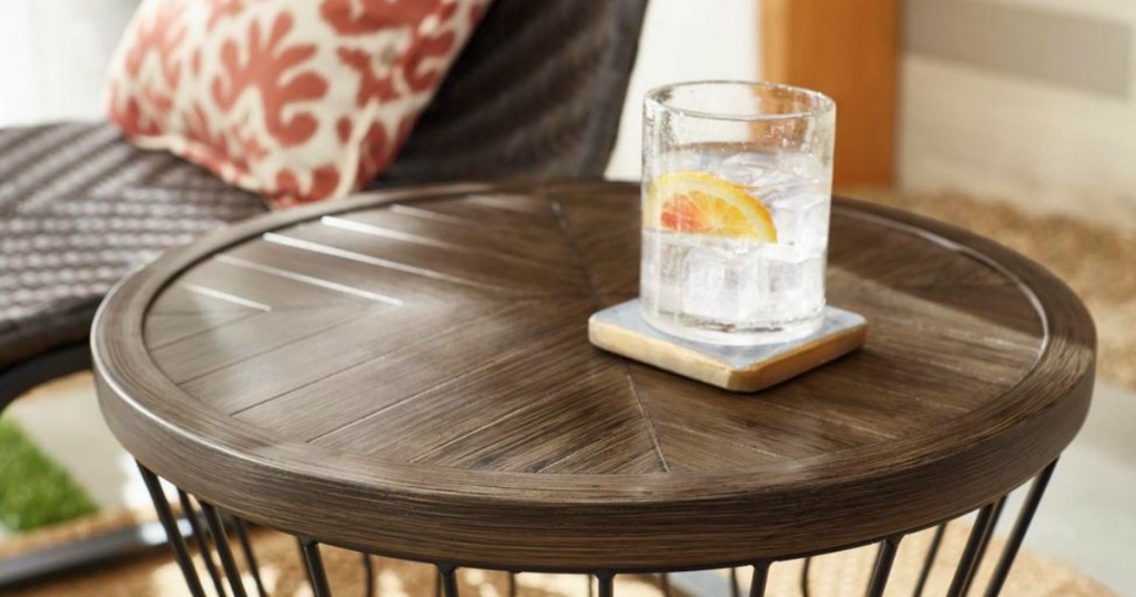 modern patio table by wicker chair
