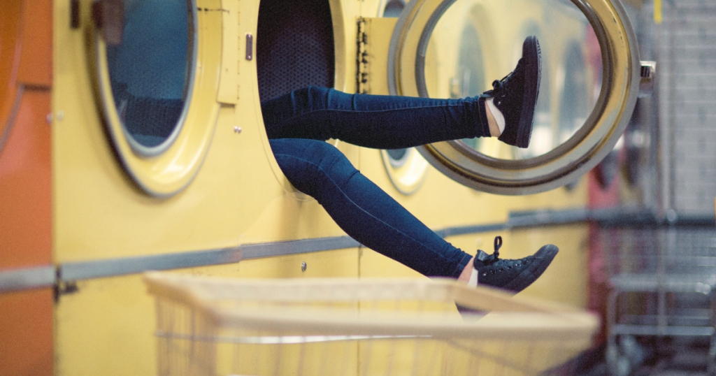 person sitting in washing machine