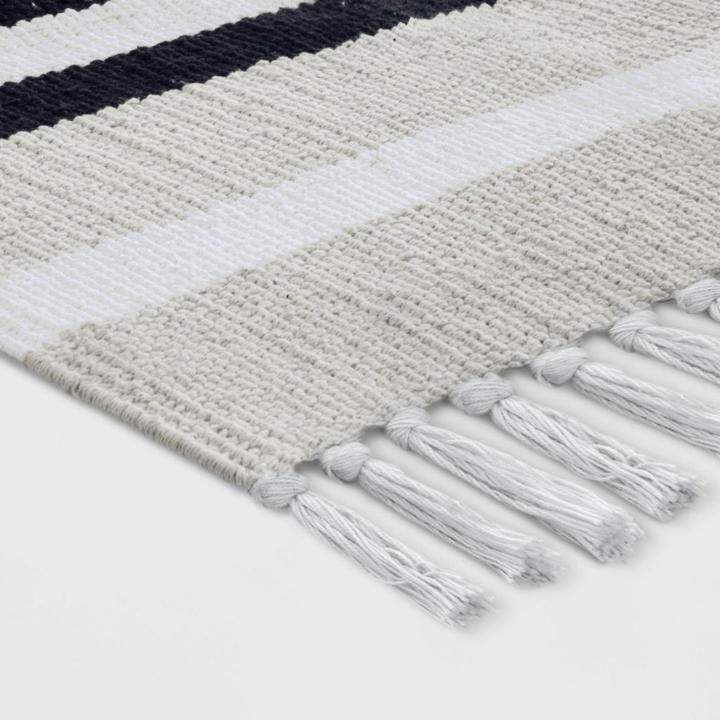 close up of striped woven accent rug