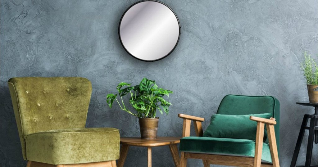 sitting area with circular decorative wall mirror