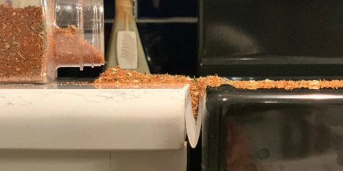 Prevent Crumbs From Falling into the Gap Between Your Countertop & Oven With This Gadget